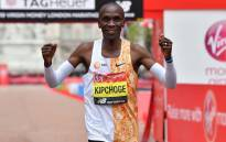 Kenya's Eliud Kipchoge poses for a photograph after winning the elite men's race of the 2019 London Marathon in central London on April 28, 2019. Kenya's Eliud Kipchoge won the men's London Marathon on Sunday in an unofficial time of 2 hours two minutes and 37 seconds - the second fastest time for a marathon. Ben STANSALL / AFP