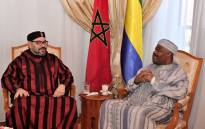 This handout picture provided by the Moroccan Royal Palace on 3 December, 2018 shows Morocco's King Mohamed VI (L) visiting Gabon's President Ali Bongo at the military hospital in the capital Rabat. Picture: AFP
