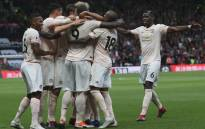 Manchester United players huddle together to celebrate Chris Smalling's goal against Watford on 15 September 2018. United won the match 2-1. Picture: Facebook
