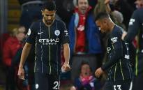 Manchester City's Algerian midfielder Riyad Mahrez (L) passes Manchester City's Brazilian striker Gabriel Jesus as he reacts after failing to convert a penalty during the English Premier League football match between Liverpool and Manchester City at Anfield in Liverpool, north west England on 7 October 2018. Picture: AFP
