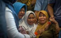 Family members of the crashed Indonesian Lion Air JT-610 react at Pangkal Pinang airport, in Bangka Belitung province on 29 October 2018. Picture: AFP.