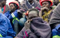 Artisanal miners watch an ongoing rescue and recovery operation at the flooded Cricket gold mine near Kadoma, Zimbabwe, on 17 February 2019. Picture: AFP