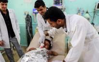 Medics treat a Yemeni child who was injured in a reported air strike at an emergency clinic in the Iran-backed Huthi rebels' stronghold province of Saada on 8 August 2018. Picture: AFP