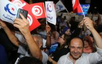 FILE: Suppoters of the Tunisian Islamist-inspired Ennahdha party celebrate in reaction to the first exit polls of the legislative elections, in front of the party's office in the capital Tunis on 6 October 2019. Picture: AFP.