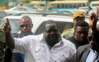 FILE: Former Zambian minister and a leading critic of President Edgar Lungu, Chishimba Kambwili, gestures while arriving at the Lusaka Magistrates Court Complex on 28 March 2018 to stand a trial on charges of profiting from the proceeds of crime. Picture: AFP