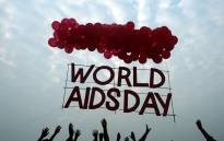 Indian social activists and children release a World AIDS Day awareness sign tied with ballons in Kolkata on 1 December, 2015. Picture: AFP.