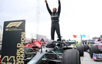 Mercedes' British driver Lewis Hamilton reacts as he gets out of his car after winning the Turkish Formula One Grand Prix at the Intercity Istanbul Park circuit in Istanbul on 15 November 2020. Lewis Hamilton won the race to seal his 7th World Championship. Picture: AFP