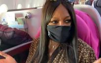 A screenshot of Naomi Campbell covering her mouth and nose with a mask as she boards her flight. Picture: Naomi/Youtube