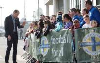 Prince William greets young fans during a visit at Windsor Park, the home of the Irish Football Association in Belfast. Picture: @KensingtonRoyal/Twitter.