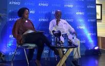 FILE: KPMG CEO Nhlamu Dlomu (left) and KPMG chairperson Wiseman Nkuhlu (right) speak at a media briefing on 15 April 2018. Picture: Katleho Sekhotho/EWN.