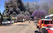 Authorities on the scene of a fire at a Pretoria West factory. Picture: ER24