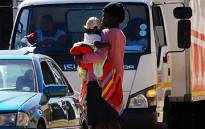 A woman and child beg for money on Republic Road in Randburg. Picture: Taurai Maduna/Eyewitness News