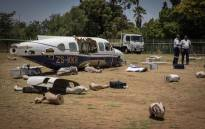 Dummies and debris from the plane crash drill litter an area designated for the simulation near OR Tambo Airport. Picture: Thomas Holder/EWN