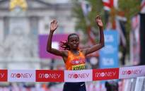 Kenya's Brigid Kosgei runs to the finish line to win the women's race of the 2020 London Marathon in central London on 4 October 2020. Picture: AFP.