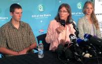 Pieter-Ben, Yolande and Lize-Marie Korkie address the press after Pierre Korkie's body arrived in South Africa on 9 December 2014. Picture: Vumani Mkhize/EWN.