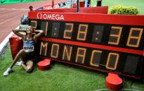 Sifan Hassan of the Netherlands poses in front of a screen reading her new world record in the Women's mile during the IAAF Diamond League competition on 12 July 2019 in Monaco. Picture: AFP