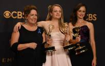 FILE: Ann Dowd, Elisabeth Moss and Alexis Bledel pose with the award for Outstanding Drama Series for 'The Handmaid's Tale' during the 69th Emmy Awards on 17 September 2017 in Los Angeles, California. Picture: AFP