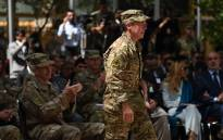 Incoming General Scott Miller (C), command of US and NATO forces in Afghanistan walks during a change of command ceremony at Resolute Support in Kabul on 2 September 2018. Picture: AFP.