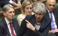 A handout photograph taken and released by the UK Parliament on 3 April 2019 shows Britain's Prime Minister Theresa May speaking during the weekly Prime Minister's Questions (PMQs) question and answer session in the House of Commons in London. Picture: AFP