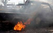 FILE: This picture taken on 24 October 2018 shows fire near the wreckage of a car reportedly destroyed in an air strike in Yemen's Huthi-held Red Sea port of Hodeida. Picture: AFP