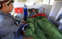 A wounded Yemeni rebel is transported by ambulance to the Sanaa International Airport, before being evacuated to the Omani capital Muscat for treatment, on 3 December 2018. Picture: AFP