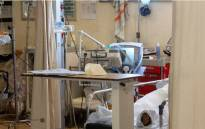 A patient with COVID-19 breaths in oxygen in the resuscitation room of the COVID ward at Khayelitsha Hospital near Cape Town on 29 December 2020. Picture: AFP.
