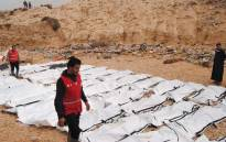 FILE: A handout picture released on 21 February 2017 by the Al-Zawiyah Branch of the Libyan Red Crescent shows Libyan Red Crescent volunteers recovering the bodies of 74 migrants that washed ashore on 20 February 20 near Zawiyah on Libya's northern coast. Picture: AFP
