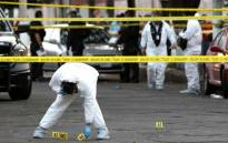 Forensic experts are seen at the scene of the crime where Mexican musician Willie, a member of the Sonora Tropicana band, was killed by armed men in Guadalajara, Jalisco state, on 18 January, 2019. Picture: AFP.