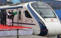 In this photo taken on 15 February 2019, Indian Prime Minister Narendra Modi (2nd L) flags off India's first semi-high speed express train Vande Bharat Express at New Delhi Railway Station. Picture: AFP