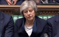 A video grab from footage broadcast by the UK Parliament's Parliamentary Recording Unit (PRU) shows Britain's Prime Minister Theresa May reacting as Labour Party leader Jeremy Corbyn informs the MPs that he has tabled a vote of no confidence in the Government in the House of Commons in London on 15 January 2019, after MPs voted to reject the government's Brexit deal. Picture: AFP