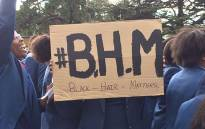 A Sans Souci learner holds up a poster during a protest on 2 September 2016. Picture: Monique Mortlock/EWN
