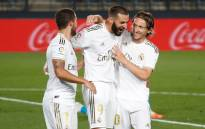 Real Madrid's Karim Benzema (centre) celebrates his goal against Valencia on 18 June 2020 with his teammates. Picture: @realmadriden/Twitter