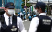 Police forensic experts (C) are seen at the crime scene where a man stabbed 19 people, including children in Kawasaki on 28 May 2019. Picture: AFP