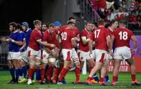 Wales' players react after back row Ross Moriarty scored a try during the Japan 2019 Rugby World Cup quarter-final match between Wales and France at the Oita Stadium in Oita on 20 October 2019. Picture: AFP