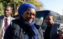 Zimbabwe's Environment and Tourism Minister Prisca Mupfumira arrives at the Harare Magistrates Courts on 26 July 2019, as she faces seven corruption charges. Picture: AFP.