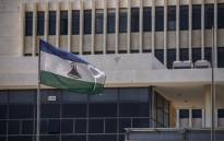 FILE: A picture taken in Maseru, on 31 January 2020 shows the flag of Lesotho outside the Parliament building. Picture: AFP.
