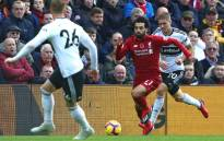 Liverpool's Egyptian midfielder Mohamed Salah (C) vies with Fulham's French defender Maxime Le Marchand (R) and Fulham's English defender Alfie Mawson (L) during the English Premier League football match between Liverpool and Fulham at Anfield in Liverpool, north west England on 11 November 2018. Picture: AFP