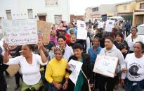 Community members protest outside the house of Courtney Pieters. Picture: Bertram Malgas