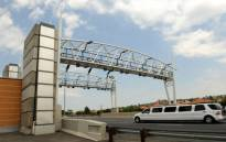 A limousine drives past a toll gantry along the N12 highway in Johannesburg on Thursday, 15 November 2012. Picture: Werner Beukes/SAPA.