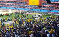 Police try to calm fans at Loftus Versveld stadium after disrupting a PSL match between Mamelodi Sundowns and Orlando Pirates. Picture: Twitter/@EWNsport.
