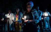 FILE: Doctors and medical staff members hold a candle-lit night vigil at Harare Hospital on 17 September 2019, to ask for the return of Dr Peter Magombeyi, the leader of the Zimbabwe Hospital Doctors Association. Picture: AFP