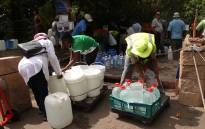FILE: Cape Town residents stock up water reserves at the Newlands mountain spring during the city's water crisis. Picture: Bertram Malgas/EWN
