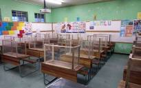FILE: Classroom desks at Talfalah Primary School, in Cape Town, are fitted with handmade COVID-19 protective screens. Image: Supplied