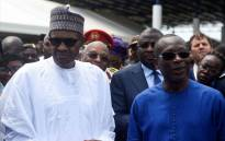 Nigerian President Muhammadu Buhari (C) and his Beninoise counterpart Patrice Talon (L) inspect the newly built Nigeria-Benin joint border posts at Seme-Krake in Badagry district of Lagos, Nigeria's commercial capital on 23 October 2018. The presidents inaugurated the newly built Seme-Krake joint border posts of the two countries to enhance free movement of people and goods and economic activities in the region. Picture: AFP