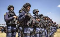 FILE: Members of the tactical response team and national intervention unit prepare for deployment. Picture: Thomas Holder/EWN.