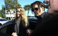 FILE: Johnny Depp and his estranged wife Amber Heard arrive at a court in the Gold Coast. Picture: AFP.