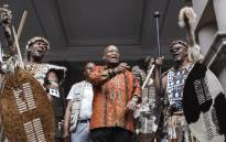FILE: Former South African President Jacob Zuma (C) dances with traditional Zulu leaders, Indunas and Amabuthos (warriors) at a meeting with hundreds of traditional leaders at the City Hall in Durban, South Africa, on January 5, 2018. Picture: Rajesh Jantilal/AFP.