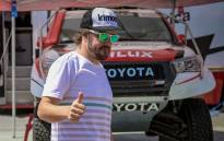 FILE: Spanish driver Fernando Alonso gives a thumb up on the sideline of the qualifying round of the Lichtenburg 400, fifth round of the South African Cross Country Series, on 13 September 2019 in Lichtenburg. Picture: AFP
