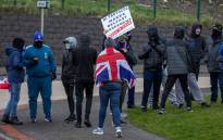 Pro-Union Loyalists demonstrate against the Northern Ireland Protocol implemented following Brexit, on the road leading to the Port of Larne in County Antrim, Northern Ireland on 6 April 2021. Picture: PAUL FAITH/AFP