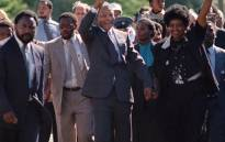 A picture taken on February 11, 1990 shows Nelson Mandela (C) and his then-wife Winnie raising their fists and saluting cheering crowd upon Mandela's release from the Victor Verster prison near Paarl.  Picture: AFP.